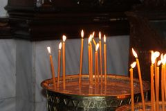 Church Wax Candles. Flame light for prayers stock images