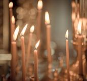 Church. Wax candles. Lighted candles in the church royalty free stock photo