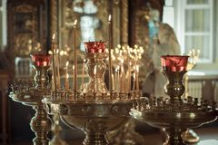 Church. Wax candles. Lighted candles in the church stock photography