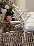 Church wedding details. A basket of order of service folders for a church wedding stock photos