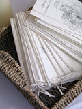 Church wedding details. A basket of order of service folders for a church wedding royalty free stock image
