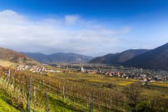 Weissenkirchen. Wachau valley. Lower Austria. Autumn colored leaves and vineyards. Church of Weissenkirchen. Wachau valley. Lower Austria. Autumn colored leaves stock photos