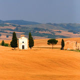 Church in wheat field. A small village church in wheat field. Tuscany Royalty Free Stock Photo