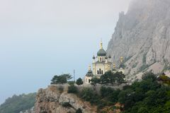The Church of the Resurrection of Christ among the rocky mountains in Foros. Crimea. The church which rises on the rock island near the Black sea stock photos
