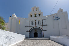 Church with white bell tower in Pyrgos Kallistis, Santorini island Stock Photo