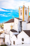 Church and white facades old village Tavira in Alentejo, Portuga Stock Photo