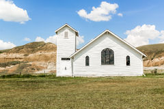 Church. White church with surrounding mountains Royalty Free Stock Images