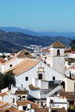Church in white town, Colmenar, Spain. Stock Photos