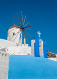 Church and windmill in Oia - Santorini. Greece Royalty Free Stock Photos