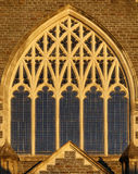 Church window. An ornate church window in evening sunlight stock images