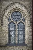 Church Window Background. One of the ornate arched windows from Haslovs Church in Sweden Royalty Free Stock Photos