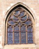 Church window with iron net for protection. Old medieval church window with iron net covering for protection Royalty Free Stock Photography