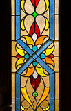 Church window. Medieval church window with colorful glass Stock Photography