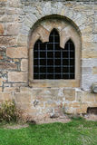 Church window. Old broken window with bars Royalty Free Stock Photo
