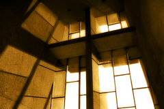 Church Window In Sepia. A cross in a church window with the sun rays shinning through Royalty Free Stock Photography