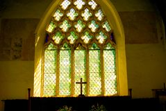 Church window silhouette. Silhouette of the cross on the altar against the chancel window Stock Photos