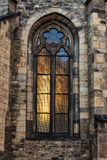 Church window. Church stained-glass window with sunlight shining through Stock Image
