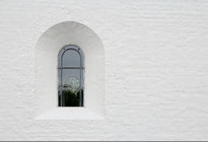 Church window in white wall Royalty Free Stock Photos