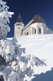 Church in winter. Winter in Slovenia, church of st. Ursula is the highest  lying church in Slovenia Stock Photography