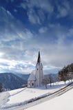 Church in winter. In Slovenian alps Stock Photos