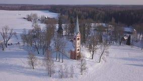 Church Winter field Krimulda Latvia aerial drone top view 4K UHD video. Aerial view DJI pro drone top view 4K UHD video stock video
