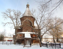 Church winter landscape  christian iron cross Royalty Free Stock Image