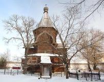 Church winter landscape  christian iron cross Royalty Free Stock Image