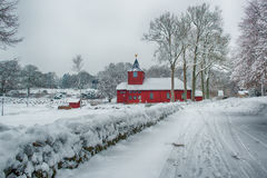 Church in winter landscape royalty free stock photography