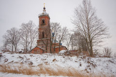 Church in winter. Old church with blue domes in winter on the hill Royalty Free Stock Images
