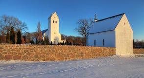Church winter snow denmark. Church in denmark. white scandinavian place of christian worship with snow in the winter Stock Photos