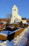 Church winter snow denmark. Church in denmark. white scandinavian place of christian worship with snow in the winter Royalty Free Stock Images