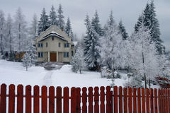 Church in a Winter Wonderland. A country church in Romania surrounded by snow covered trees in a winter wonderland scene stock photos