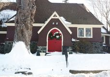 Church. This church in Massachusetts is ready for Christmas with a red door, a green wreath, and white snow royalty free stock photography