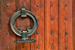 Church wooden doors and intricate metal hinges Royalty Free Stock Photo