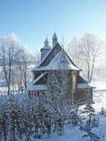 Church. Wooden church in the winter snow robe Stock Photo