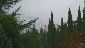 Church in the woods. In the background mountains in fog.  stock video footage