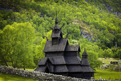 Church in the Woods. A shot of the stave church of Borgund, showing the woods around Royalty Free Stock Images