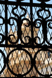 A church through a wrought iron gate, from noto. A foreshortened detail of the facade of a church through a wrought iron gate, from noto, sicily, portrait cut stock photos