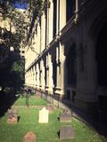 Church Yard. EARLY MORNING SUNSHINE ON THE HISTORY TRINITY CHURCH LOCATED AT NEW YORK, New York Royalty Free Stock Photo