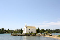 Church of Ypapanti, Gouvia, Corfu, Greece. Historic church of Ypapanti (Corfu, Greece) is lying on its own islet in the waters of Gouvia bay and very close to Stock Photography