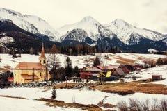 Church in Zdiar village with Belianske Tatry mountains, Slovakia Royalty Free Stock Photo