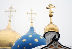 Churche domes, crosses, pigeons on roof. Three domes of  christian churches, two pigeons on the roof. Taken in Trinity Sergius Lavra, Russia. UNESCO World Royalty Free Stock Images