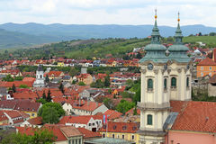Churches buildings and houses on hills Eger cityscape Stock Photo