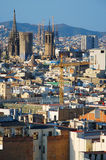 Churches and cranes. Aerial view of Barcelona, with Sagrada Familia and Barcelona Cathedral Royalty Free Stock Photo
