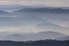 Churches in foggy landscape Royalty Free Stock Photography