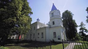 White orthodox church in a small summer town in Latvia