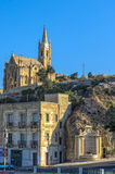 Churches of Malta - Gozo, Mgarr. The 20th-century neo-Gothic Church of Our Lady of Lourdes, Mgarr, Gozo, Malta Stock Image