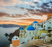 Churches of Oia village during beautiful sunset, Santorini Royalty Free Stock Images