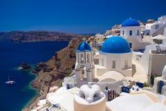 Churches of Oia village, Santorini, Greece Stock Photos