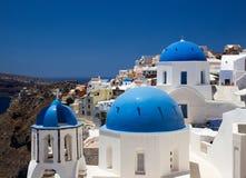 Churches of Oia village, Santorini, Greece Stock Photo